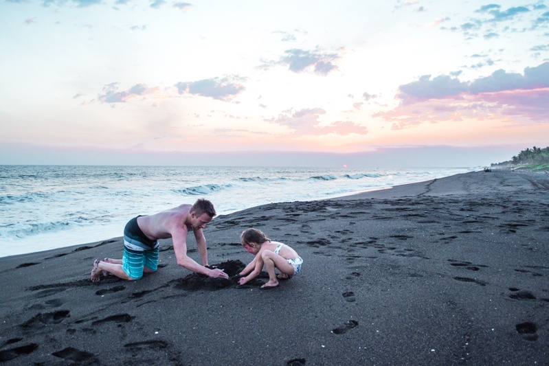 Playing on the beach at sunset